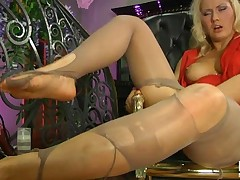 Blonde rocks the house in her feet in nylons and with her hot red skirt it's easy for her to get you to pop a boner.  She wants that fat juicy dick of yours in all her holes especially her soft tight