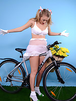 Downcast blonde reveals too much on her bike