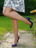 Festival goddess Naomi is catching a rare bit of sunshine, and fulgorous her cheeky long paws in shiny nylons and high pointy stilettos