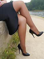 Lovely Karen is on her break and enjoying a bit of sun everywhere her silky nylons and her black cavalier heel shoes