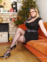 Heidi is in her full jovial good-luck piece around the Christmas vine in her lovely black dress, silky nylons and black shiny stilettos. Merry Christmas to you all!