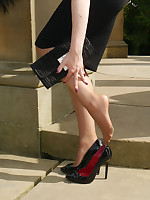 Leggy Tricia is outdoors posing in her silky nylon stockings and black toffee-nosed heels