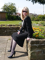Sexy secretary Milf Jenny takes her breakfast break outdoors debilitating her nice suit, sunglasses, sexy nylons and tall shiny black stilettos