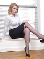 Hot secretary Jenny reveals her gorgeous blackguardly nylons and sexy high heel shoes at home
