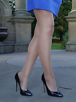 Sexy Tricia flashes her silky long nylon legs coupled with shiny disgraceful high heels outdoors