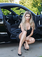 Gorgeous multi-storey blonde Kathryn is behind the wheel of a nimble Audi sport car, in pretentiously Negro shiny pair of stiletto heels