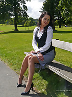 Hot babe Maria teases her sexy legs increased by shiny black high heel shoes in the park