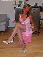 Very naughty girl in pink see through lingerie, white nylons and heels