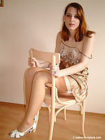 Long legs redhead in sexy lingerie and suntan stockings
