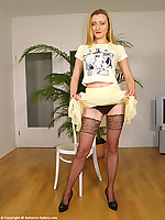 Sexy striptease in mini skirt,pumps and brown stockings