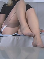 Larissa teasing with her feet in seamed nude nylons