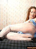 Girl in white pantyhose self-pleases