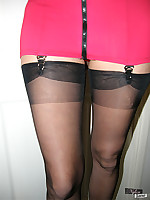 Sexy Jane wearing tight red mini skirt and black nylons