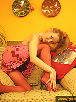 Blonde teen girl in pink pantyhose enjoys herself