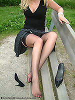 Babe outdoor showing legs and feet in sheer black nylons