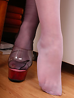 Welcome to Pantyhoseinnylons.com The secretary in black colored stockings over hose