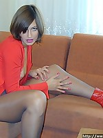 Girl in red boots shows her pussy through pantyhose