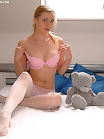 Nasty teen blonde in pink lingerie and white stockings