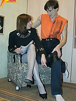 Two young lesbians petting each other by pantyhose and tongues