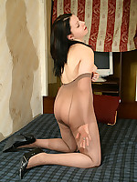 Girl pleasures herself playing with pantyhose