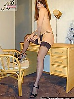Lady in  leopard-color dress and stockings  undressing - pretty legs in nylon