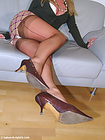 Leg show by babe in brown seamed nylons and vintage pumps