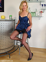 Leggy blonde milf stripping her evening dress in black nylons