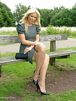 Sultry blonde with great smile posing outdoors in her high heels.