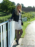 Gorgeous blonde Erin is outdoors showing off say no to shiny legs covered in silky nylon and say no to beautiful black stilettos