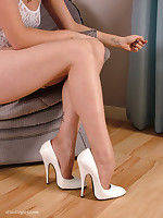 White high heels and matching white lingerie on this stunner