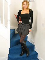 Saucy secretary Hayley-Marie in a skimpy outfit in the air patterned grey pantyhose and kinky black boots.