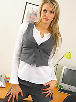 Ellie wearing a secretary outfit with shorts and dark grey pantyhose