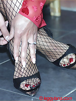 Horny Lana gives the brush bloke a great footjob in fishnet stockings