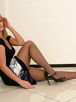 Hot leggy blonde Kathryn buckles up her overweening heels in sexy nylon stockings together with a beautiful throb black dress
