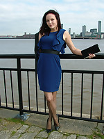 Cute Carrie is outdoors in a lovely sexy dress with a pair of seamed stockings and a pair of executioner stiletto heels on