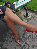 Gorgeous Kerry teases her beautiful silklike nylon legs more a pair be fitting of red stiletto heels on her feet