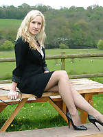 Sexy blonde Iona is posing outdoors on a wooden bench in someone's skin countryside, wearing a lovely black pair of stilettos
