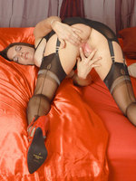 Michelle Thorne in output girdle and bra poses like one another off suntan ff nylons!