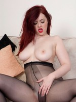 Redhead, black pantyhosed clad Jaye telling the brush own toy story!