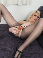 Blonde plaything Bianca rips her pantyhose open