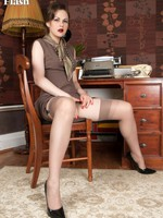 Tina's in her home office wearing for all to see insufferable girdle and vintage nylons!