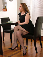 Sexy Anna flashes her stockinged legs increased by shiny black stilettos as she poses increased by teases