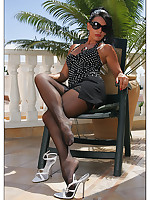 Milf Eve in Black Hold Near Stockings